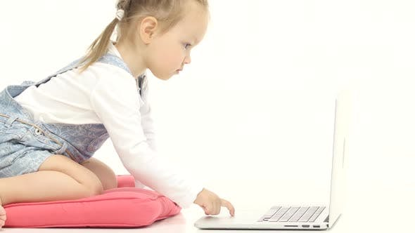 Thumbnail for Little Girl Types the Text on the Keyboard. White Background. Close Up