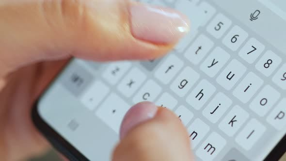 Thumbnail for Hands Typing Text on Smartphone Close-up