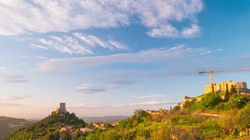 Time lapse at sunset: Rocca d'Orcia, a medieval village and fortress in Orcia Valley, Tuscany, Italy