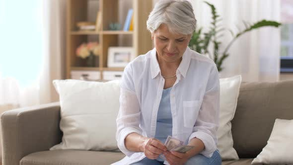 Thumbnail for Senior Woman with Money and Bills at Home