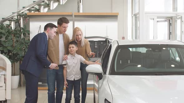 Affable Salesman Consult Customers in Cars Dealership