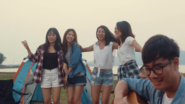 Group of Asia best friends teenagers give high five and dancing enjoy with guitar music.