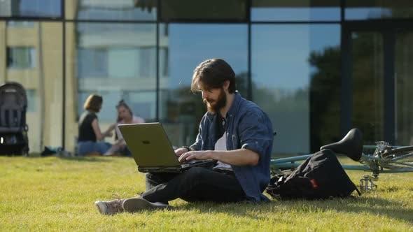 Man Studies Near University