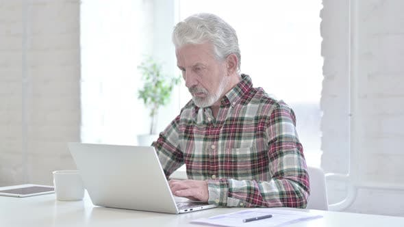 Casual Old Man Working on Laptop