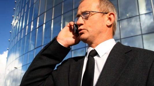 Thumbnail for Serious Senior Businessman with Glasses