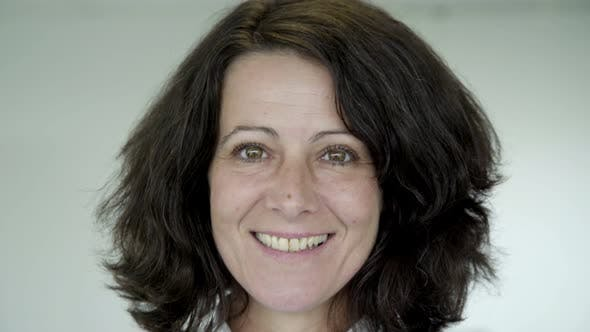 Cover Image for Happy Middle Aged Woman with Green Eyes Looking at Camera