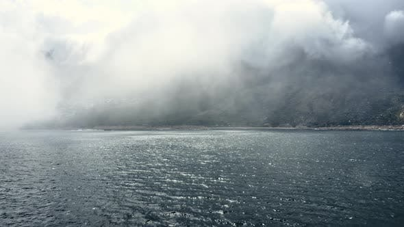 Thumbnail for Mountain View Covered By Thick Fog with Rippling Ocean Waters