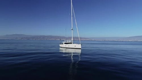 Sailboat Floating on Tranquil Sea