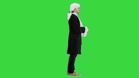 Man Dressed As Mozart Greeting Someone on a Green Screen, Chroma Key.