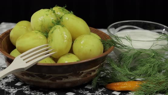 Thumbnail for Adding Fresh Dill To Boiled New Delicious Potato on Plate on Table