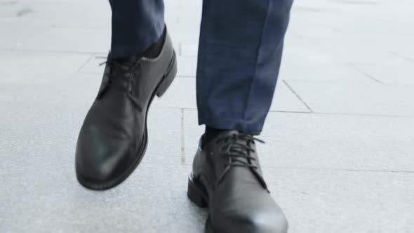 Thumbnail for Businessman Legs Walking on City street.Entrepreneur Wearing Black Leather Shoes