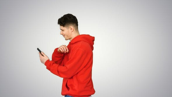 Handsome cool casual man listening to music in smartphone
