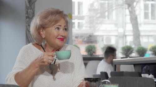 Senior Woman Meeting Her Mid-aged Daughter at the Coffee Shop