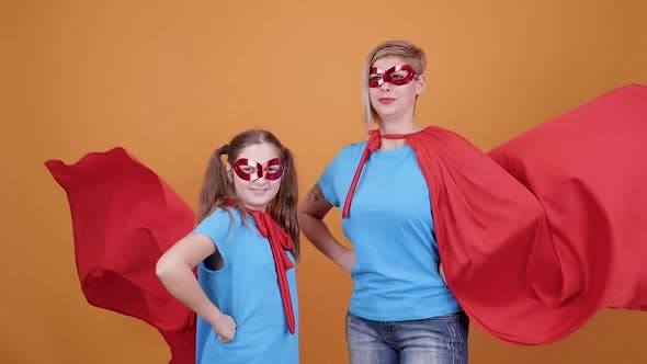 Thumbnail for Cute Teen Girl with Her Mom Pretending To Be Superheroes