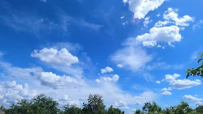 Blue Sky With White Fluffy Clouds - timelapse