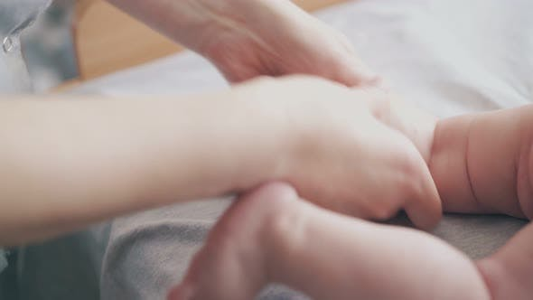 Thumbnail for Pediatrician Holds Newborn Baby Leg and Practices Massage