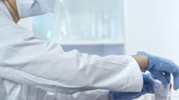 Female lab technician working in medical facility