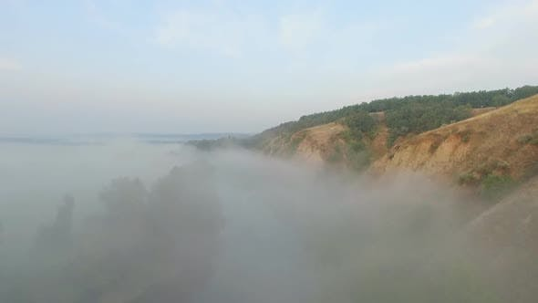 Thumbnail for Aerial Shot of Beautiful Natural Landscape. Amazing Scenic View on Valley Covering By Thick Fog
