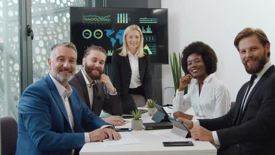 Thumbnail for Successful Multiracial Corporate Coworkers Posing on Camera During Meeting