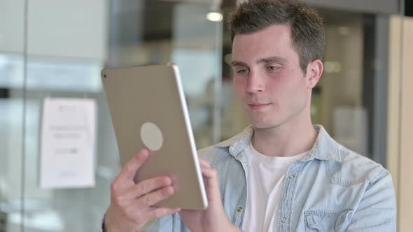 Portrait of Attractive Young Designer Using Tablet in Office