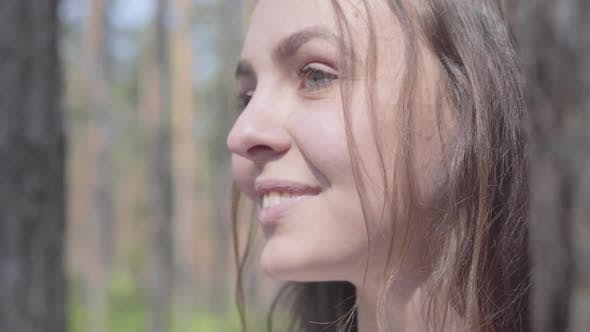 Thumbnail for Close-up Portrait of Happy Smiling Young Woman Looking Around in Pine Forest. Concept of Camping