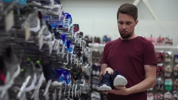 Man Buying Running Shoes
