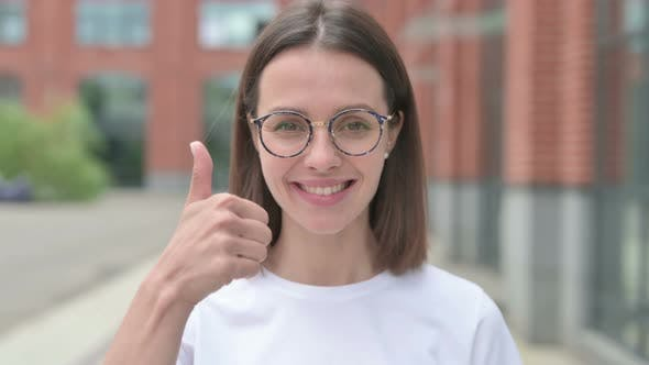 Thumbs Up by Young Woman, Outdoor