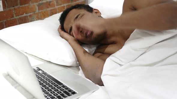 Thumbnail for African Man in Bed Reacting to Loss and Failure on Laptop