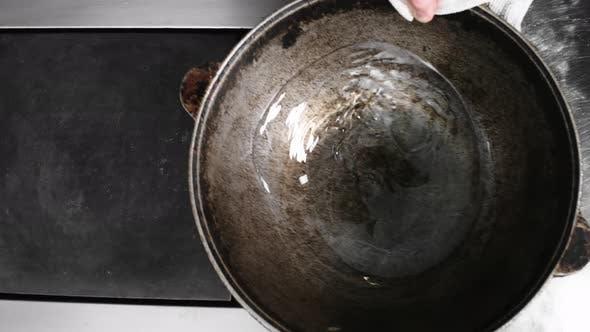 Adding Oil into Dutch Oven