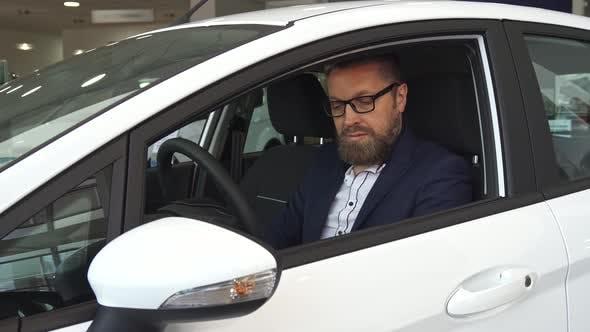 Thumbnail for Male Customer Examines Car Interior at the Dealership