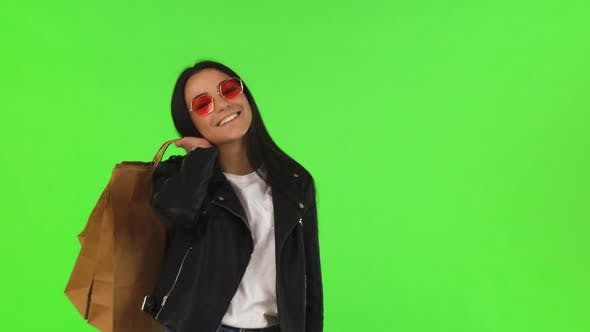 Thumbnail for Happy Young Woman Posing with Her Shopping Bags on Chromakey
