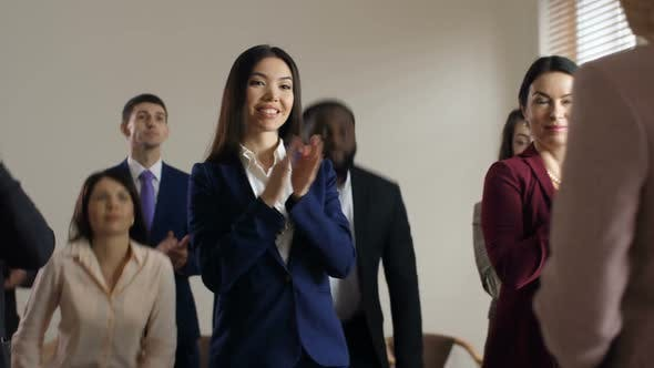 Thumbnail for Joyful Diverse Employees Welcome Executive Manager