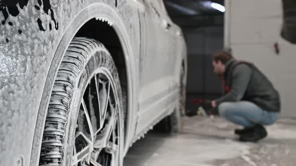 Foam Drops From a Modern SUV During Car Wash
