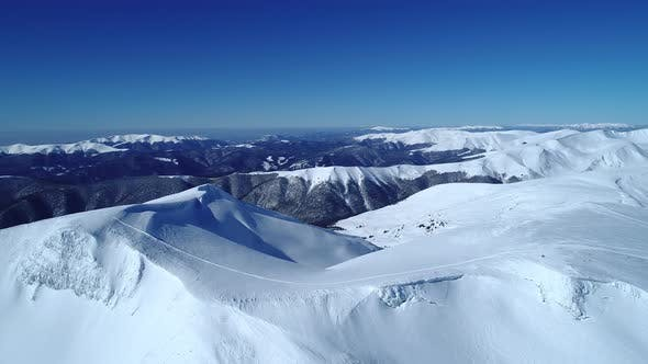Cover Image for Flight Over the Turquoise Snowy Mountains Illuminated By the Day Sun