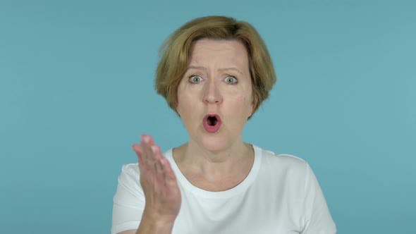 Thumbnail for Fighting Old Woman in Anger Isolated on Blue Background