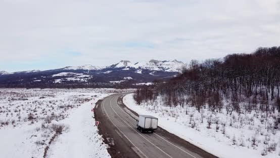 Thumbnail for Deep Winter Rural Country Landscape Flying Over Along Deserted Road