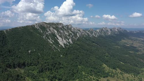 Lateral flight over the mountain ranges of Veliki Krs in Eastern Serbia 4K drone video