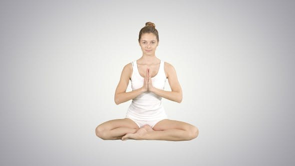 Thumbnail for Cute fitness woman exercising yoga sitting in lotus pose