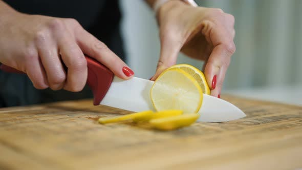 Thumbnail for Female Hands Cutting Fresh Juicy Lemon