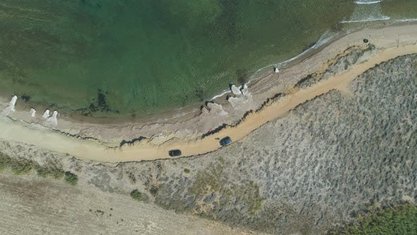 Thumbnail for Top View of Two Cars Driving Along Coastline in Lemnos, Greece