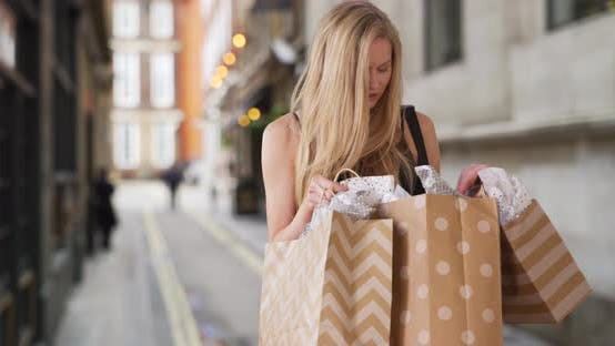 Beautiful Caucasian female shopaholic happy with her most recent buys