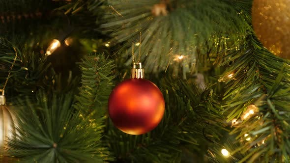 Thumbnail for Red bauble and sparkling fairy-lights 4K 2160p 30fps UltraHD footage - Close-up of Christmas ornamen