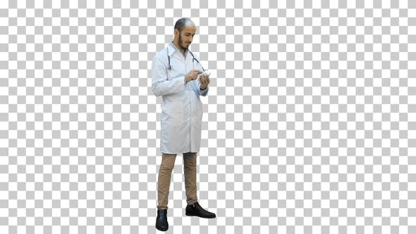 Thumbnail for Male doctor attentively reading label, Alpha Channel