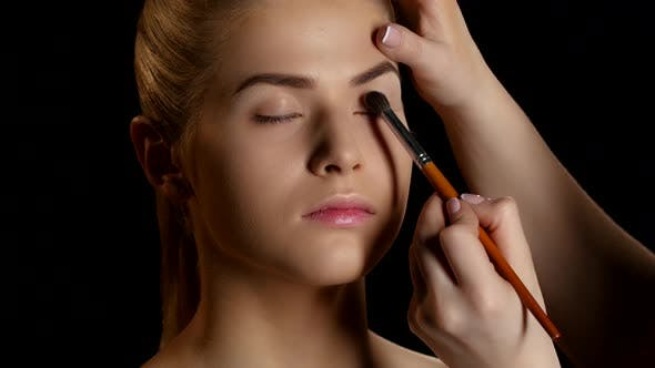 Thumbnail for Eye Makeup Woman Applying Eyeshadow Powder. Makeup. Black. Closeup