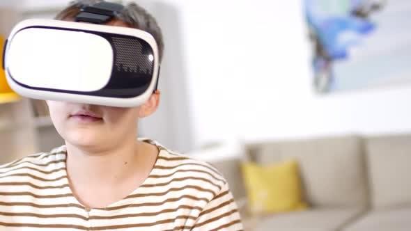 Thumbnail for Teenage Boy Experiencing Virtual Reality Indoors