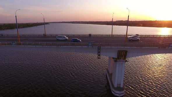 Thumbnail for Aerial Shot of a Lofty Bridge Over the Dnipro at Shining Sunset in Summer
