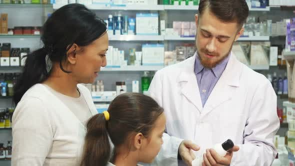 Thumbnail for A Young Pharmacist Talks About One of the Pharmacy Products To His Customers