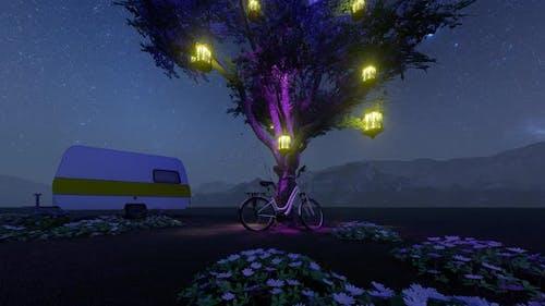 Illuminated Tree and Caravan Milky Way View