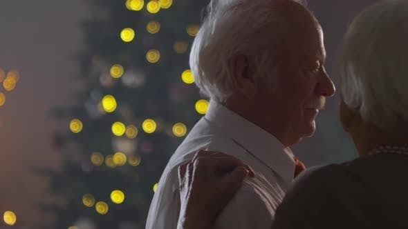 Thumbnail for Elderly Couple Dancing Together on Christmas Eve