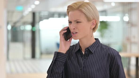 Thumbnail for Aggressive Young Businesswoman Angry on Smartphone